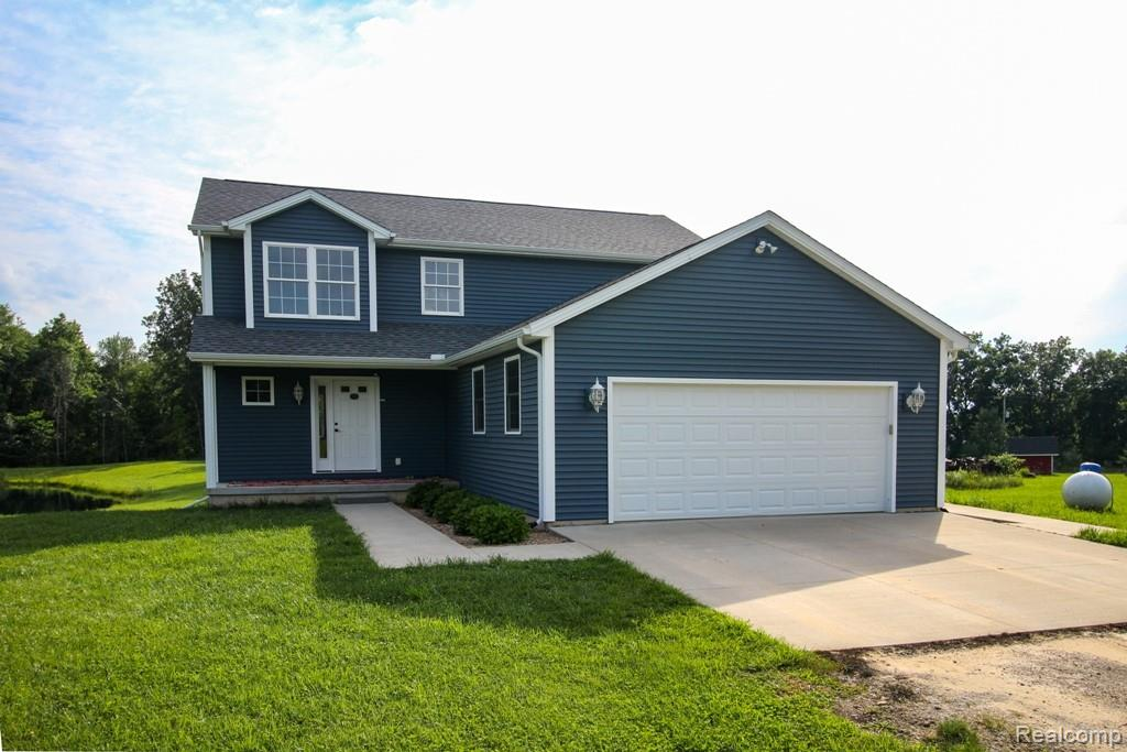 Outdoor enthusiast , homesteaders & gentlemen farmers, this is your dream come true. Beautiful newer home on 20.92 acres with 24x32 pole barn. Cement floor, water, electric & 2 lofts. 2 acres of fenced pasture w/2 auto waters, 6 paddocks. Trout pond 20 ft. deep also has walleye & perch. 2nd pond w/bass, blue gill & sunfish. Both ponds are aerated. Garage used as a custom exempt meat processing facility for deer and lamb. Home features spacious living room w/southern yellow pine wood floors. European oil finish. Wood stove, built in book shelves. Home theatre w/Dolby 7.2 surround sound. Fabulous kitchen & dining area w/master craft cabinets, farm sink, upscale stainless steel appliances & floating island. 4 bedrooms upstairs. Master suite w/private bath & walk in closet w/built ins. Part finished w/o LL w/home office. Live off the land. Tons of wildlife, fruit trees & other edibles. Ask your agent for the additional feature sheet in documents. Too much to mention.
