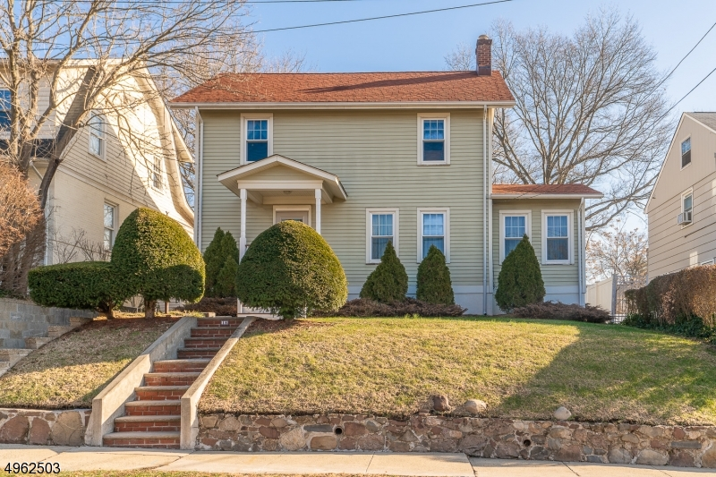 Welcome home to this CHARMING COLONIAL home, one block away from downtown center of Millburn. As soon as you walk in you are welcomed in a foyer area that leads to the living room, den and formal dining room. Through the kitchen there is a half bath, and an inviting 3 season porch. The upstairs has 4 bedrooms, full bath and the ability to walk to the attic through the hallway. Enjoy a fully finished basement that has a family area, sitting room that leads to an enormous backyard great for entertaining. There's also a full bath and laundry area. 4 Miles from the train that takes you directly to NYC, close to shopping, schools, parks and restaurants are an ADDED BONUS!.