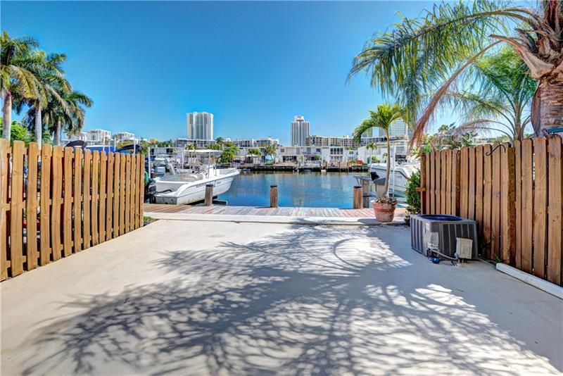 ELEGANTLY UPDATED WATERFRONT TOWNHOME CENTRALLY LOCATED IN DESIRABLE RESORT STYLE PRIVATE COMMUNITY. WATCH THE SUNRISE FROM YOUR PRIVATE WATERFRONT PATIO OR BALCONY. THIS HOME FEATURES A DEEDED DOCK ON THE WIDEST CANAL SECTION IN THE COMMUNITY OFFERING BOAT ACCESS TO THE INTRACOASTAL & OCEAN. IMPACT WINDOWS! FULLY TILED, NO CARPET! STAINLESS STEEL APPLIANCES & TOP OF THE LINE WASHER/DRYER. MINUTES TO BEACH, SHOPPING, RESTAURANTS AND GULFSTREAM RACETRACK CASINO. TURN KEY, MUST SEE, DONT MISS OUT!