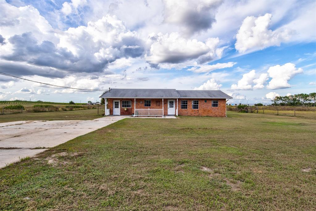 LOCATION, LOCATION, LOCATION! Enjoy country views from this gorgeous 3/2 Single Family home laying over 0.97 acres. No Carpet! Fresh paint! A nice Barn and one Shed are included. Appliance are in a very good condition.