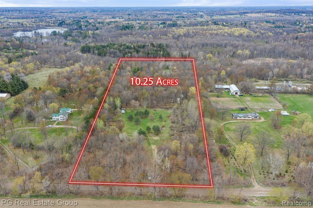 Rare opportunity to own private acreage in northern Oakland county.  This 10.25 acre lot is located in desirable Addison Township and a sizeable portion has been cleared for entry and building a dream home or structure.  The agriculture zoning allows for the most versatility as one can build their dream home (live) and operate a commercial business in privacy surrounded by woods and trees.  In the cleared area you'll notice a beautiful scene with several Austrian pine trees.  The property is enclosed by partial woods in the front and side and full majestic forest in the back providing maximum privacy and serenity.