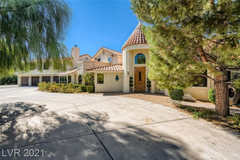THIS CUSTOM HOME IS CLASSIC VEGAS! TOO MANY UPGRADES AND FEATURES TO MENTION! BEAUTIFUL WOOD FLOORS AND BEAMS THRUOUT.KITCHEN FEATURES GRANITE COUNTERS, TWO OVENS, TWO DISHWASHERS AND TWO CUSTOM PANTRIES.CUSTOM STONEWORK IN LIVING AND FAMILY ROOMS.SEPARATE PANTRY OFF THE FAMILY ROOM FOR WINE/BEVERAGE PREP/STORAGE.PRIMARY BEDROOM FEATURES DRESSING ROOM/GIANT CLOSET. PRIMARY BATHROOM FEATURES UPGRADED STAND ALONE TUB W/GOLD PLATED FOOTINGS, TV, TOWEL WARMER, DUAL HEAD SHOWER AND BIDET. ADDITIONAL BEDROOM UPSTAIRS FEATURES FIREPLACE WITH SLATE TRIM. ADDITIONAL BATHROOM UPSTAIRS FEATURES HIGHLY UPGRADED SHOWER WITH MULTIPLE SHOWER HEADS, STEAM HEADS AND FOOT SHOWER HEADS.BOTH UPSTAIRS BEDROOMS HAVE FRENCH DOORS LEADING TO THE BALCONY THAT FEATURES CITY VIEWS AND COOKING AREA. UPSTAIRS BALCONY ALSO LEADS TO SEPARATE OBSERVATION DECK. INDOOR POOL WITH NEWER PEBBLE-TECH FINISH AROUND POOL.SPACIOUS GROUNDS FEATURE MATURE LANSCAPING AND FRUIT TREES. FRONT YARD FEATURES SERENITY AREA AND GAZEBO.