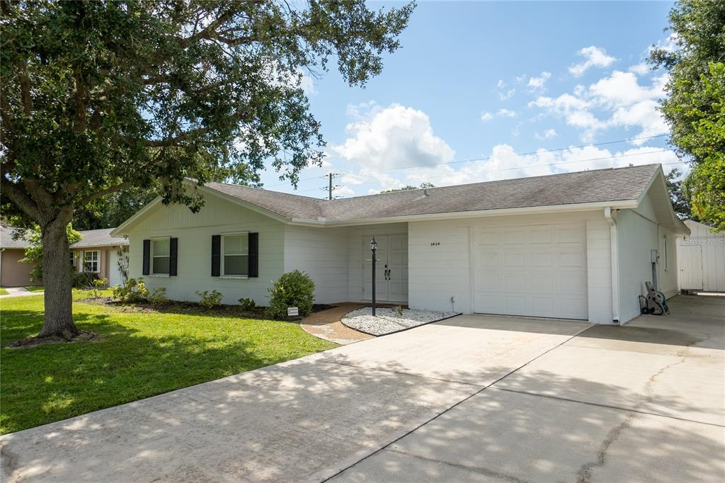 This 3 bedroom/3 bath home sits on a large lot with a completely fenced-in spacious backyard offering plenty of room to add a pool.  With generously sized living rooms, kitchen and dining area, there is plenty of space to spread out. Bright white cabinetry, appliances and fixtures lighten up the kitchen and baths while neutral toned walls and flooring allow any decor to work. Ceiling fans in every room help keep the space cool. A single car garage and detached shed in the backyard allow for extra storage of your goodies. Several cars can be parked on the oversized driveway. Berber carpet is found in the bedrooms and living room while ceramic tile flows through the kitchen, dining room, entranceway and baths. It wouldn't take much to make this house your home. Come tour it today before it is gone!