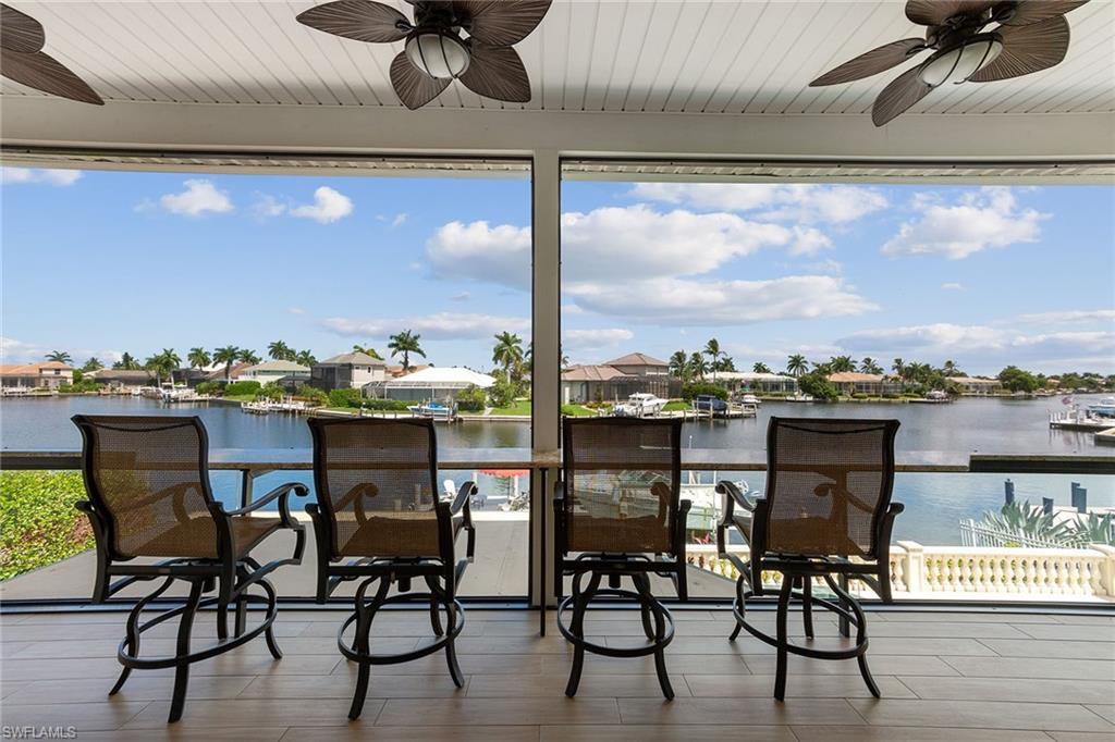 Fantastic wide water views and incredible Marco Island sunsets from this beautifully updated 3,988 square foot, 4-bedroom, 3-bath home. The kitchen has a Wolf stove and convection oven, Thermador refrigerator, microwave, and 2 wall ovens, a perfect place to enjoy cooking with family and friends. A boater's dream with direct access and a short distance to the Marco River. The residence had extensive remodeling done by Cornerstone Builders in 2017, which included new porcelain tile floors throughout the house. A new large window in the kitchen to enjoy the beautiful view. 3 renovated bathrooms. All new hurricane glass sliding doors on both levels. New front door. A new built-in 200-bottle temperature-controlled wine cabinet along with two 35-bottle built-in cabinets in the bar area. New screened outdoor kitchen with gas grill and TV. 2nd-floor deck with long granite counter to never miss a fabulous sunset. 10,000 lb boat lift and two 1,000 lb jet ski lifts. Great dock to enjoy relaxing by the water. Built-in gas generator with replaced propane tanks. This home is perfect for entertaining and enjoying the fabulous Marco Island lifestyle.