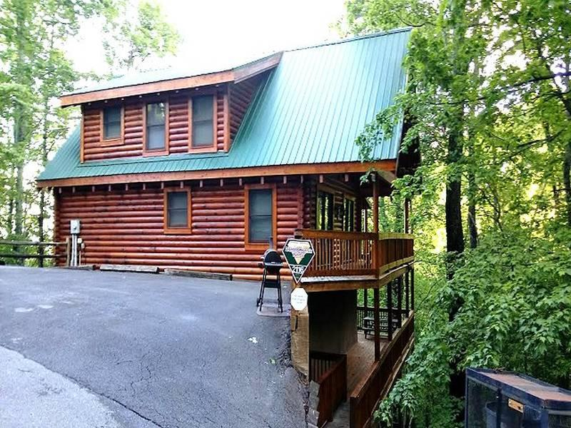 """GREAT VALUE in this 3BR/3BA log with incredible views of both the Smoky Mountains and the city of Gatlinburg with spectacular night time views. Natural wood throughout with cozy living/dining room combo, fully equipped kitchen with all the amenities including washer/dryer. Game room w/ pool table with Hot Tub on covered deck to take in the views both day and night. One king master suite on main level, with whirlpool tub. Additional queen bedroom with whirlpool tub on lower level, and one full bed with full bath.  Located in the Ski Mountain area just minutes from Ober' Gatlinburg and all the activities and just 5 minutes from the Gatlinburg """"strip"""".   This Cabin has three levels;  Lower Level which is identified as First Level; Main level is identified as """"Second Level""""."""