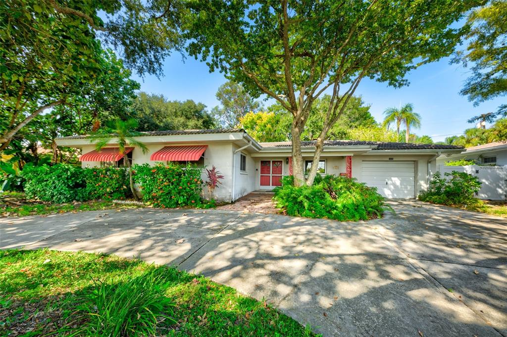"""Not all rentals are created equal! Rarely does an opportunity present itself to purchase a home that has been """"grandfathered in"""" as a short-term rental at Mandalay of Clearwater Beach. This endearing 3 bedroom, 3 bath fenced tropically landscaped home offers plenty of room for any family and/or guests. Within 1 block walking distance to the #1 beach in the US with private beach access, one can enjoy beautiful Gulf of Mexico sunsets every evening. Plenty of parking in the circular driveway (very important as parking is a premium at Clearwater Beach)! French doors open into the great room: built-in bookcases, tile floors, open floor plan. The kitchen with its marble flooring is ideal for any family. Dine in the formal dining room complete with marble flooring! The Florida room is light & bright: beamed ceilings, glass block walls & access to the fenced backyard complete with pergola & outdoor grilling space. The master bedroom has bathroom en-suite. Each of the 2 additional bedrooms share a full bathroom. This home will sleep 8 comfortably! Additional 3rd full bath is in the garage a perfect spot for beach clean-up. Walk, bicycle or golf cart to the Clearwater Beach community recreation center, pool, tennis courts & boat ramp."""