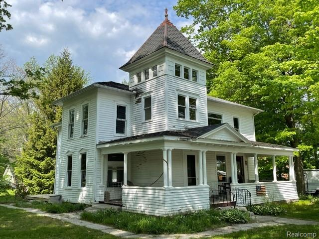Historic home with character in Mayville.  2 city lots. 3 story barn.