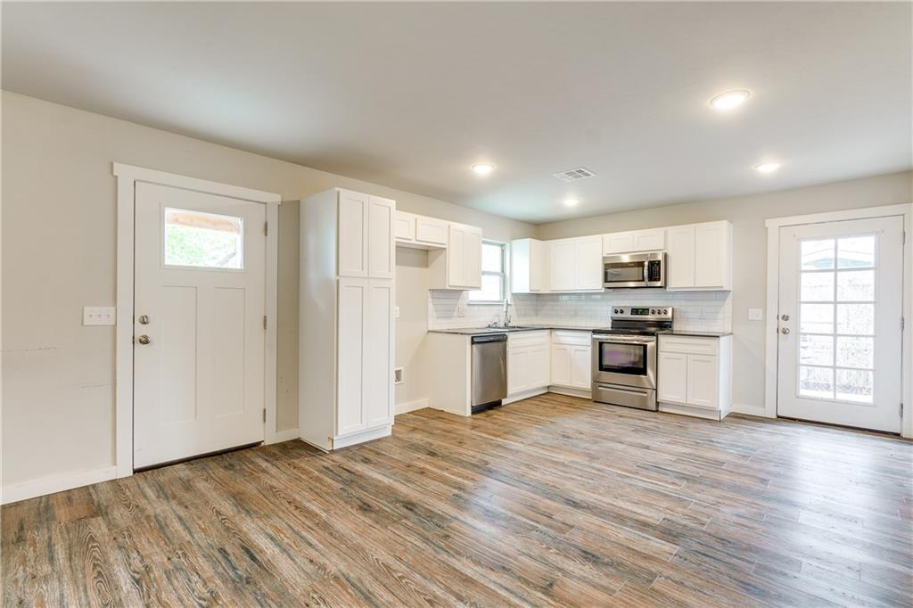 This home is the best of both worlds: a newer build (2018) in a historic area of okc! A true 3 bed and two bath. where modern meets a traditional style home for anyone looking to live nearby OCU, the restaurants and life of Uptown23rd, Classen Ave, Midtown and close to downtown etc.  An open living to kitchen concept welcomes you into the front door with wood style floors, a sleek white kitchen and dining area that then meets a hallway that takes to the back half where you find the bedrooms and bathroom. One restroom meets the hallway for shared access and another larger restroom and walk-in closet are attached to the back larger, private bedroom.