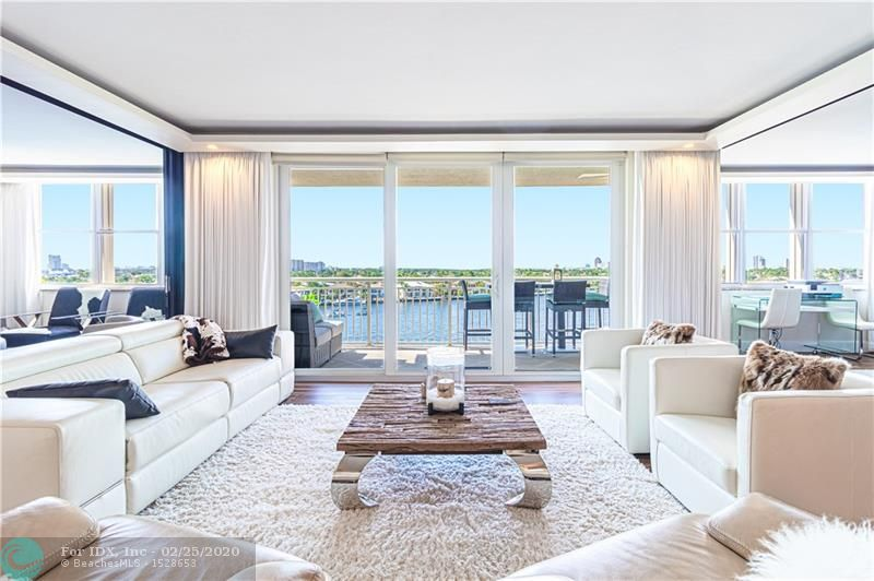 An Amazing redesign, turning this 3 bedroom 3 bathroom unit, into a versatile floor plan that opens living space for entertaining, or transforming back to its original plan with ease, through custom sliding glass walls that provide a panoramic view of the Intracoastal. Completely redone! Everything feels brand new, from the kitchen cabinetry, appliances, custom bar, all bathrooms, flooring throughout, lighting, sound system, fire places, accent walls, built ins, bar with wine cooler and ice maker, window treatments and much more. Building amenities include club room, billiard room, kitchen facilities, fitness center, heated pool, saunas, BBQ grills, & roof top sun deck. Wide Water views of the Intracoastal, ocean and downtown Fort Lauderdale. Walk to the beach!
