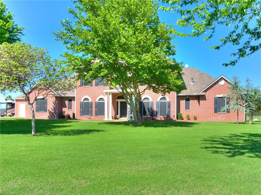 Do NOT miss this Updated Beautiful traditional home that has EVERY amenity you want!This traditional spacious home is nestled on 1.86 acres in the back of a secluded gated community in the highly sought after Deer Creek School District.Heated Pool with slide, Hot tub, Outdoor kitchen, Playset, Fire pit, Shop, Generator,Garden,Craft room,Storm Shelter And so much more!Complete with a beautiful farmhouse master bath suite with shiplap walls and an antique claw foot tub!New paint throughout.New hot water tanks and new well pump.New roof on shop and house!Includes Security cameras, Ring and an alarm system. Sprinkler system and even water to the raised bed garden.Also includes new pool/hot tub heater, new hot tub jets and new pool/hot tub lights that change color!The shop is 35x30 and is full brick with 1/2 bath,electric and is heated and cooled!Alarm, cameras, ring and pool/hot tub are utilized by apps on your phone! WOW! Addition has a fishable pond! Licensed Realtor related to seller.