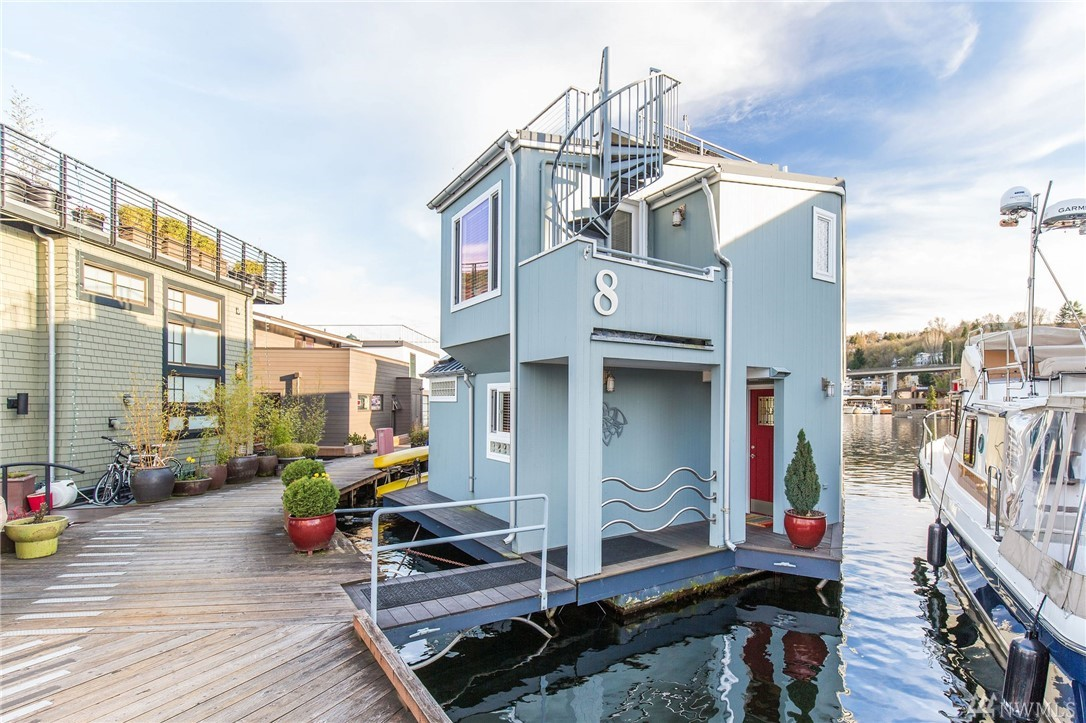 Come aboard and love your life on this fun floating home wrapped in the sun-kissed views of sparkling Portage Bay.  Enjoy all the playful activities waterfront living has to offer with magical sunrises and fiery sunsets as your back drop. This open great room blends fine cooking and fine dining in the most perfect way to entertain with the main floor deck at the water's edge. Sip champagne and get a bird's eye view of all the goings on from the roof top deck. Great community on this coop dock.