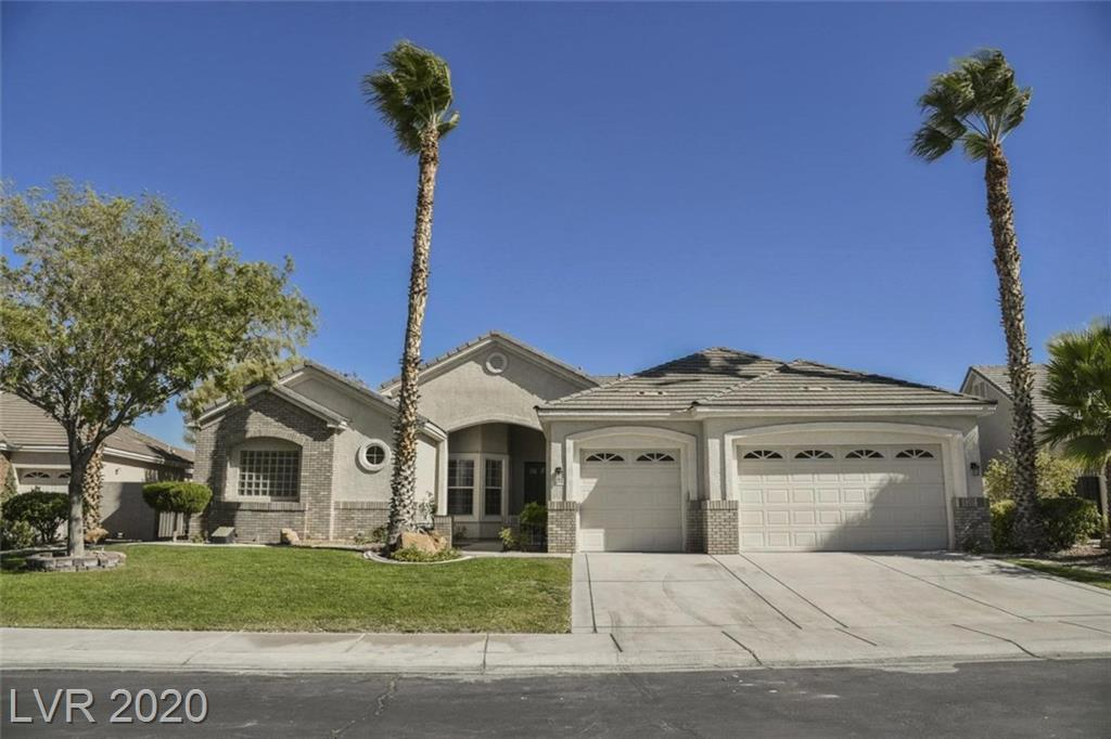 STUNNING Summerlin home tucked away on a quiet cul-de-sac in a gated community! As you enter this home the GRAND entrance features HIGH VAULTED ceilings and TRAVERTINE tile. The spacious kitchen offers BRAND NEW stainless steel appliances and QUARTZ countertops. THREE car garage! The custom designed backyard is an ENTERTAINER'S DREAM with a covered patio and a walk up bar at your crystal clear POOL! This home is bound to go fast come see TODAY!