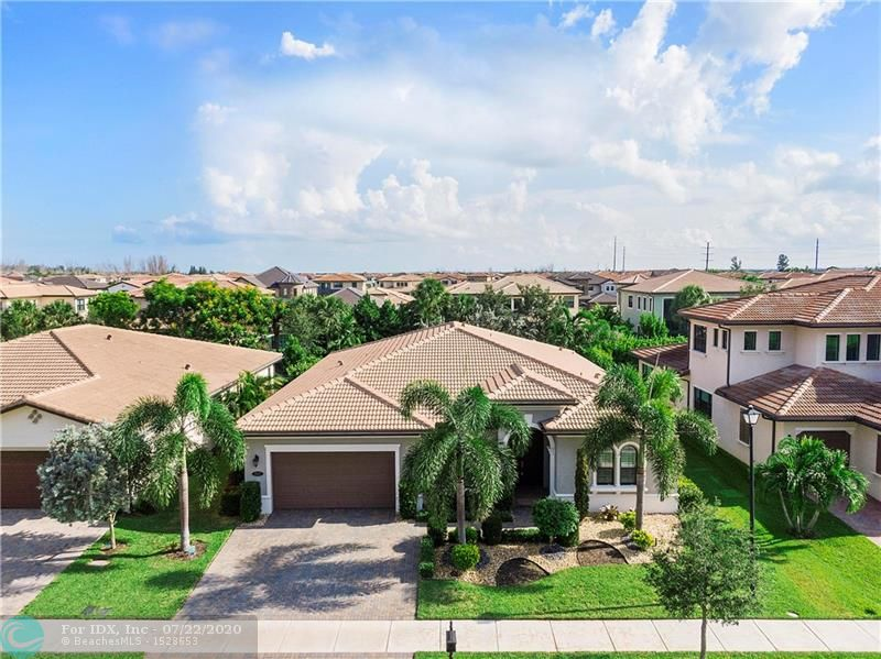 Located in one of Florida's best school districts & in Parkland's highly desired comm, Watercrest. This thoughtfully planned home is an entertainer's dream with its extremely flexible floor plan, enormous kitchen island (comfortably seats 6), upgraded appl. (gas range/vent hood & wall oven w/convection micro), & surround sound. The massive, master retreat features 2 built-in, walk-in closets & a spa-like bathroom including a soaking tub and shower/wet room. Other luxurious upgrades include: crown molding, wainscoting, ceiling box beams, plantation shutters, motorized lanai shade, & a 3-car tandem garage housing built-in cabinets with an expanded driveway. This home is immaculate and ready to be shown. Masks, booties and gloves are REQUIRED upon entry and provided by the seller on arrival.