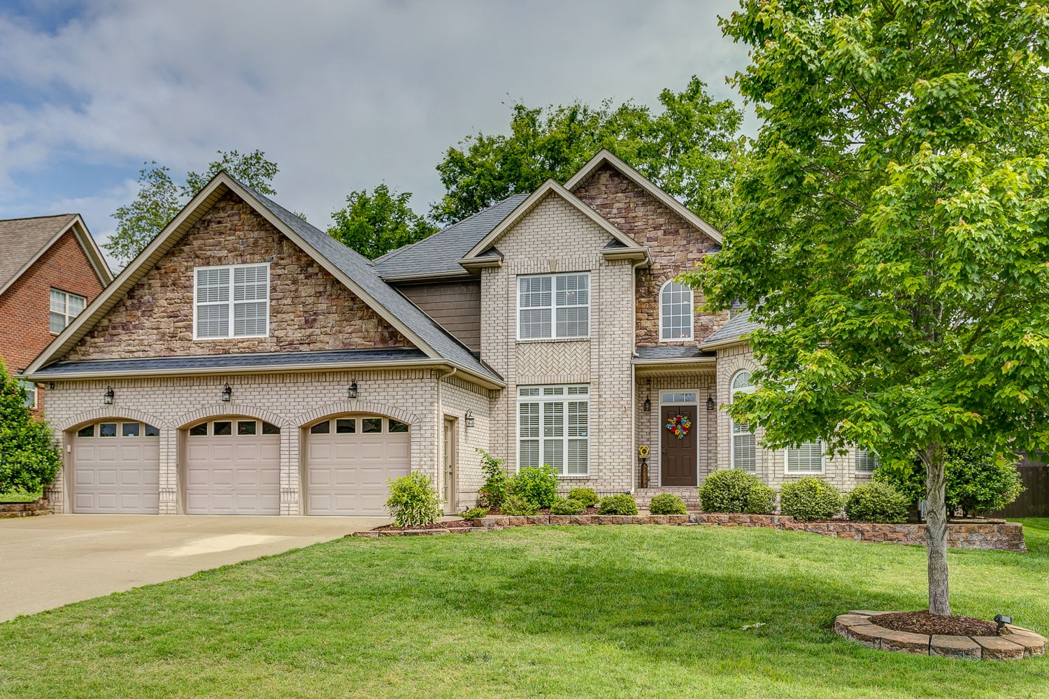 AMAZING Williamson County Spring Hill home with private fenced yard and 3 car garage.  This home boasts a secondary first floor bedroom with hardwoods; perfect for a bedroom or an office.  Enjoy the open concept layout and spa like master bathroom.
