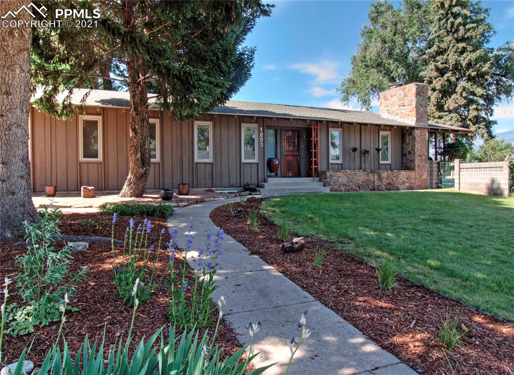 Must-see beautiful contemporary 4 bedroom, 3 bath ranch home that has many unique architectural features.  Located close to downtown and Memorial Park.  Enjoy stunning Pikes Peak views from the covered patio.  You will find main-level living at its finest in this well-thought-out open floor plan. Spacious master bedroom with double vessel sinks and walk-in steam shower. Additional bedroom or office on the main level, a full bathroom, and the laundry area. The lower level features a wet bar, spacious family room, workspace, two bedrooms, and an updated bathroom. You will also find a separate entrance for someone looking for an income opportunity or even a mother-in-law suite.  Don't take my word for it, come and check out this immaculate home today.