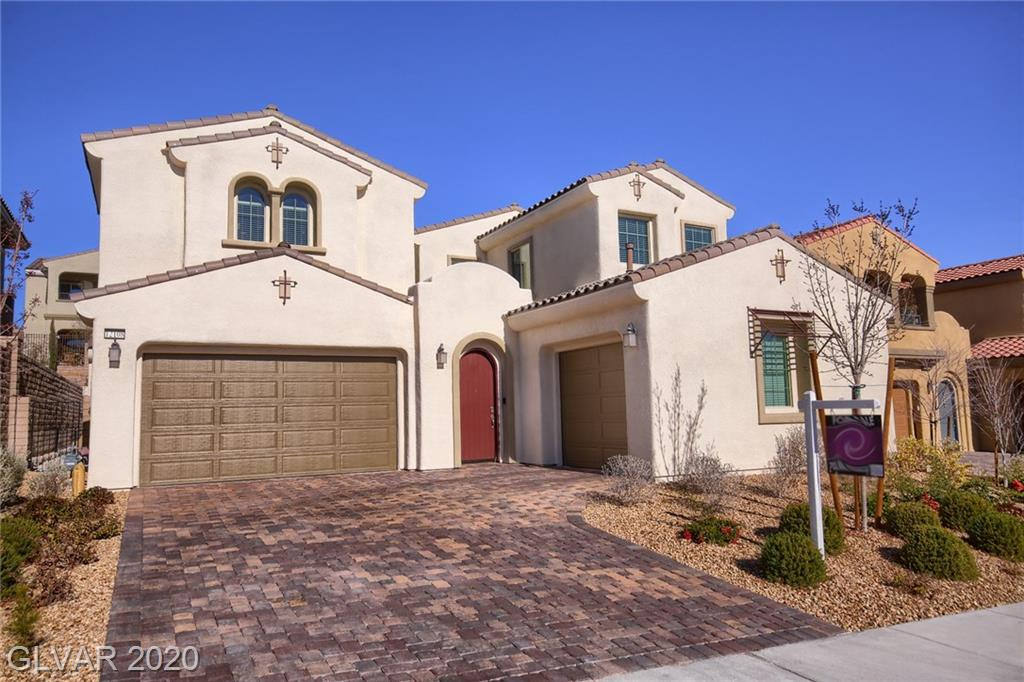 Amazing Gated home located w/in the Paseos of Summerlin*Pool size lot*True Chef's kitchen includes Cust Cabs, 3 SS convection ovens, built-in Fridge/Freezer, Lg walk-in pantry, Butler's Pantry & much more! Profile Frplace in Fam rm and stunning outdoor Frplace under huge patio cvr*Upstrs boasts massive loft that opens into bdrms and balcony*Master bath is Spa like W/Huge Center Tub*Master Bdrm has covered balcony*Must see-Too much to list!