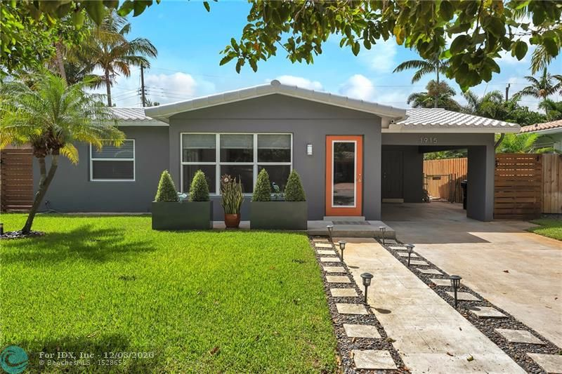 Wow! Breathtaking mid century modern designer remodeled home in the perfect Fort Lauderdale location! Beautifully renovated 3 bedroom/2bath home with open concept plan. Exquisite modern kitchen featuring white quartz countertops, stainless steel appliances, walnut cabinets soft close doors & drawers. Custom Italian porcelain tile floors throughout the whole home set the stage for this masterpiece. The list goes on and on including, impact doors and windows, master bath with double vanities and rain shower, upgraded electrical, new hot water heater. Exceptional workmanship and planning all with permits. Hurry, this home is special and will not last!