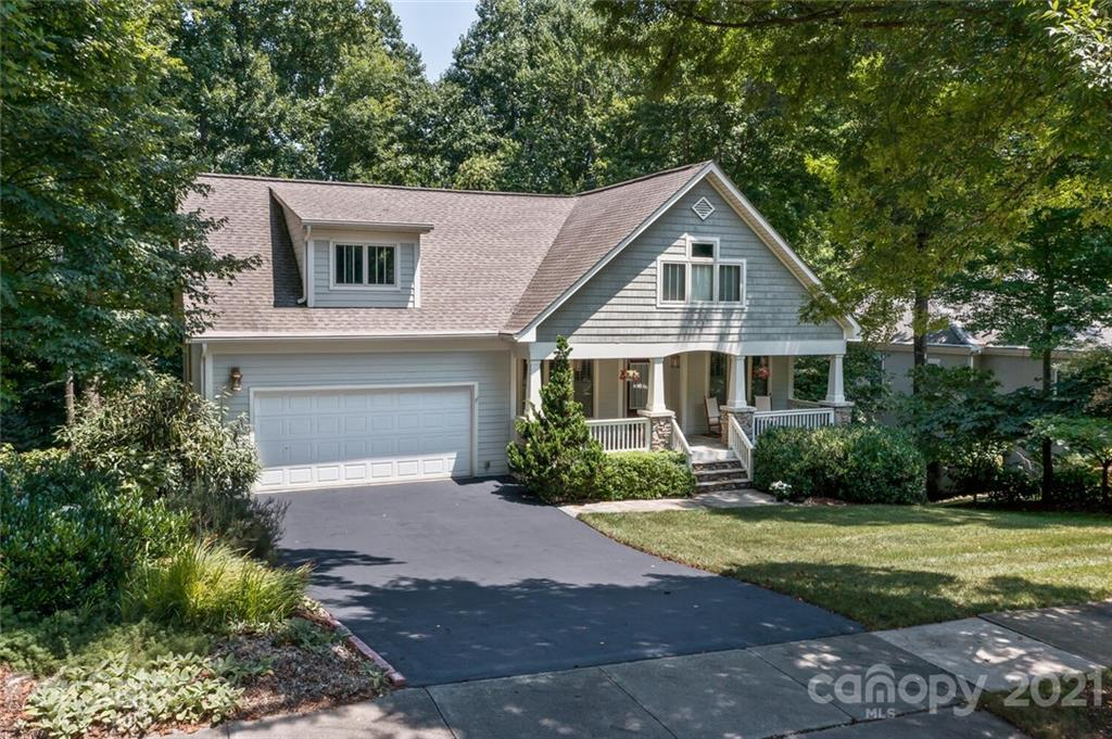 This elegant traditional yet modern home has 4 bedrooms/3 bathrooms. Walk up to the elegant, welcoming covered porch with custom stone flooring. Enter into the foyer and see the dining room on the right and on the left a beautiful office-reading room with a full wall of custom built-in bookcases. Main floor living area has 2 bedrooms, 2 bathrooms. Upstairs are another 2 bedrooms, bathroom and bonus room to use as an office, craft room. Large open kitchen, walk in pantry, breakfast room & bar for stools Screened  outdoor room leads to a grilling porch and then to a spacious & lush private back yard that is perfect for a hammock, fire pit, dogs, and entertainment. Large unfinished basement is framed out, insulated, and the bathroom stubbed in. Swim, kayak or canoe  in the 62-acre lake, lounge on the sandy beach or dock, relax in the clubhouse..walk or run on the manicured trails. Basketball, tennis, and playgrounds all provided by HOA. Minutes to downtown Asheville.