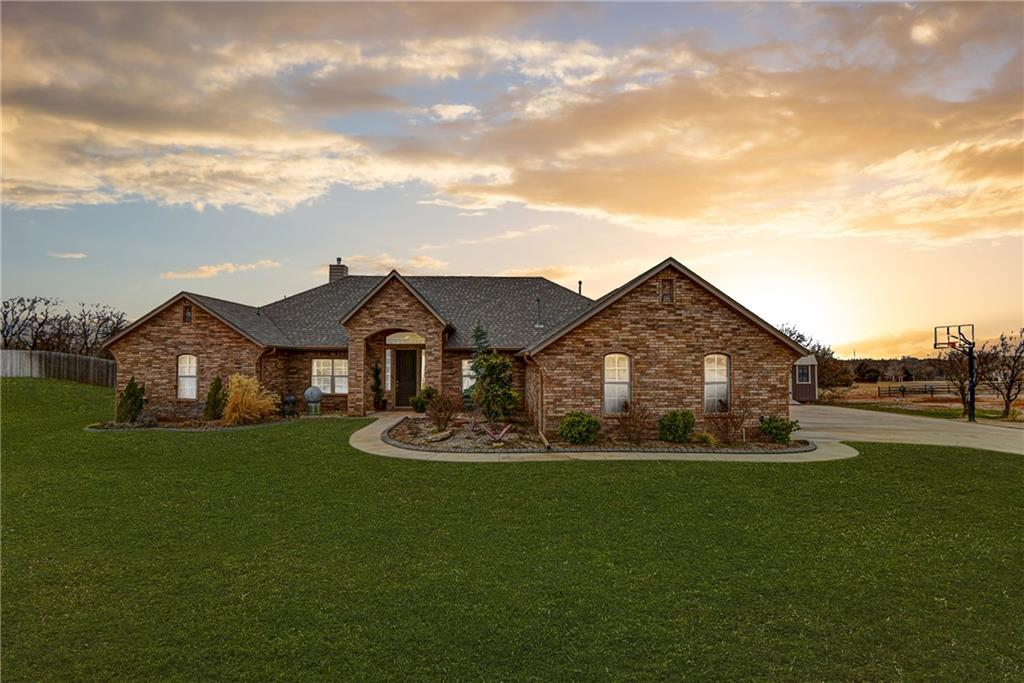 This Edmond home is full of custom details and finishes. Sitting on a spacious lot just under a full acre. Living room features tray ceilings, a corner fireplace, and large windows with a view of the breathtaking backyard. The kitchen opens up to the living space to create an open floor plan. Inside the kitchen you'll find gorgeous details such as stylish subway tile backsplash, custom cabinetry, and a large center island. State of the art appliances such as the double ovens makes this a chef's dream! Sprawling master suite features a luxury en suite with a walk-in shower, large soaking tub, and a long vanity with tons of storage. A formal dining and a study complete this floor plan! The home has been beautifully maintained, all it's missing is it's new owners!