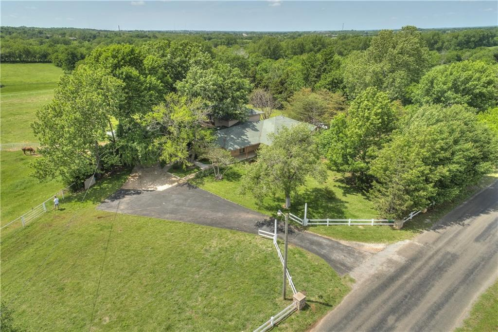 You'll be thrilled with the awe-inspiring views from anywhere on this beautiful 35-acre property as you look out over rolling hills tree-lined pastures,a creek and fully-stocked pond just 10 min from Norman.Sit on the floating dock and spy deer or turkeys wandering by as you view a beautiful Oklahoma sunset. The 3662 sq ft home w/natural stone siding includes custom wood cabinets, lots of storage, and the biggest kitchen island you've ever seen.Concrete barn w/stalls & extensive oil-pipe fencing make this the perfect horse property.A number of amenities on the property are useful for managing horses & cattle. A loading chute surrounded by 5 small to moderate size pens or corrals w/multiple gates make separating animals easier.The rest of the 35 acres is divided by oil pipe fence into 4 large pastures.Two large loafing sheds in 2 separate pens and 1 small loafing shed in a 3rd pasture area provide plenty of shelter.Wooden barn w/3 small stalls & office or feed room.