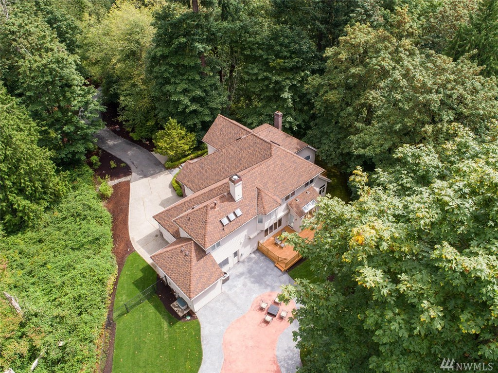 PRICE REDUCED! Come home and be away from the outside world!  Enjoy this very private estate surrounded by greenbelt with the convenience of being just minutes away from Microsoft, freeway access, Marymoor park and shopping.  Hardwood entry, and Hallway and vaulted ceiling invites you to this large home.  Great room/Bonus room on the main floor, large gourmet kitchen with island and access to the new deck overlooking the backyard surrounded by nature! One of a kind estate!