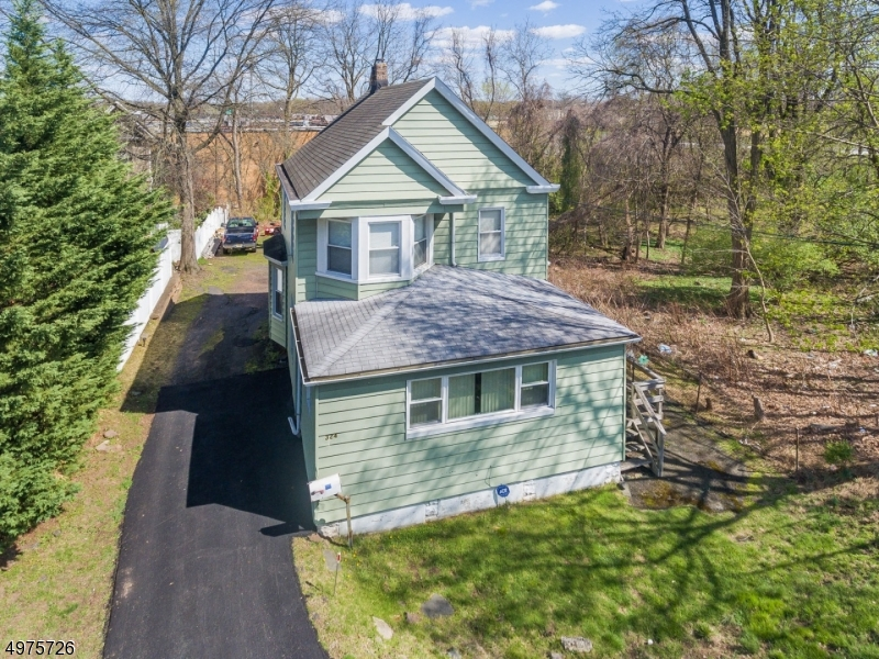 Amazing opportunity to own this home in the desirable Millburn Township! The land is zoned for Commercial Medical Office which is HIGHLY rare and one of the only areas in town left to develop. Don't miss out on this affordable and huge upside building opportunity!