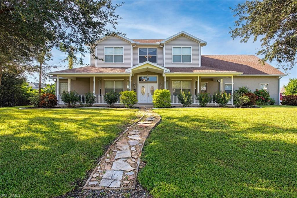 NO HOA FEE! Spectacular custom-built home on sprawling half acre corner triple lot. The very best of country living and city amenities. Close to schools, shops, dining, and beaches. This wonderful two-story home features 4 bedrooms and 4 full bathrooms. Private ground floor master suite with two walk-in closets, double sink, garden tub and walk in shower. All bedrooms have walk in closets with built in shelving. HUGE BONUS ROOM with wet bar, full length attic storage and space for office/den, home gym, teenager hangout, or game room. Large kitchen with lots of counter space, wood cabinets, and breakfast bar. Formal dining for those special occasions or perfect as a home workspace. Dining area and family room feature wood burning fireplace and soaring 20' ceilings. Lots of windows provide natural light throughout the home. Hurricane shutters on first floor and impact windows on the second story. Expansive covered lanai and large swimming pool & spa combo are screened in with direct access to a full bath. Laundry room has extra storage and a built-in computer desk. The property is completely fenced for pets and privacy. 3 car garage provide extra storage space. Big Expansive driveway