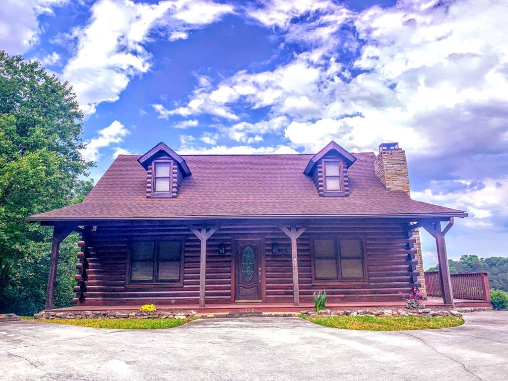 Great Views in the city limits of Pigeon Forge!  3 bedroom, 2.5 bath cabin in fantastic shape.  This property has only been used as a second home and has been very well taken care of. Sold furnished with a few exceptions.  Would make a great permanent residence or second home.  Close to everything Pigeon Forge and close by Sevierville and Gatlinburg have to offer.  No steep roads to contend with. New stain and deck in 2020, new windows in sunroom and stucco was removed from chimney and replaced with rock.  Main level has living room, dining, kitchen, sunroom with its own fireplace with built ins on each side, half bath, Master bedroom suite with walk in closet and laundry room.  Also a large deck that wraps around the side of the cabin.  Upstairs there is a loft area with a small bed, full bath, two bedrooms and the one in the back has a walk out onto an upper deck that is covered. This deck contains the hot tub in a screened in room of it's own and the other section has a porch swing to sit and enjoy the views. Nice balance of covered and open decks to enjoy the outdoors.  There is also some decking on the basement level with steps leading down giving easy access to the yard below, storage or air units. ***This property is zoned R-1 in Pigeon Forge and cannot be used as an overnight rental property.   Contact agent to show today! **As with all Real Estate transactions you should verify all information independently including but not limited to all HOA info., restrictions including any that may have been recently added, and square footage.  Buy Title insurance, have a survey, home inspection, and all other needed inspections. Buy insurance. Equal housing opportunity. Most information from Tax records and not verified by listing agent/Company. BUYER TO VERIFY.