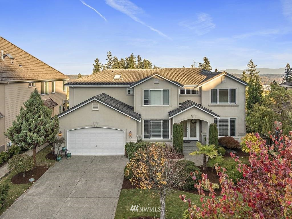 Stunning custom-built, 2-story home on perimeter lot in Jornada. Beautifully-landscaped backyard boast spectacular views of Mt. Rainier & Cascades! Gardener's dream frontyard provides inviting entry through double doors. Hrdwd flrs, vaulted/coffered ceilings, w/designer touches throughout. Open floor plan, spacious kitchen w/granite island & plenty of cabinets & counter space. Master BR feat 5-pc bath with jetted tub and private balcony! Tons of natural light, 3-car garage, 2 gas FP & much more!