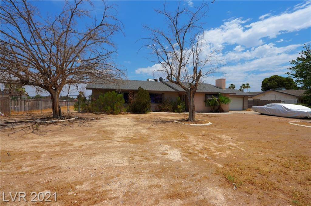 WONDERFUL, OLD VEGAS STYLE, 4 BEDROOM RANCH WITH A SPARKLING POOL! OVER SIZED LOT WITH PULL-THRU RV PARKING. DIRECT ACCESS OFF OF CHEYENNE AND ALSO GAREHIME. CORNER LOT, HUGE ADDITION ON REAR OF HOME WITH WETBAR FIREPLACE AND SUNKEN PARTY ROOM!  THIS HOME IS ON OVER A HALF ACRE, NO HOA, POSSILBE FUTURE COMMERCIAL ZONING. THIS HOME IS IN THE CITY NOT COUNTY.  A MUST SEE, THIS HOME HAS IT ALL!!!