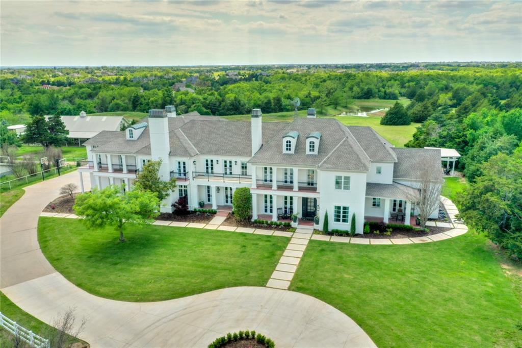 You will not want to miss out on this completely updated estate sitting on 21.5 Acres!!! This home was taken to the studs in 2019 and 90% rebuilt on the inside!  Truly a one-of-a-kind Property! Almost every interior surface is new!  2 'master suites' downstairs plus a Bar/Bonus room, walk-in Temperature controlled wine cellar and TO DIE FOR KITCHEN!! It's a MUST SEE! The upstairs Master retreat offers a full living room, fireplace and private kitchen along with multiple balconies over looking the incredible grounds featuring 2 large stocked ponds and beautiful sunsets!  3 more bedroom suites upstairs with a workout room, bonus sitting room and 2nd Laundry! Views for days!!!Included in this one of a kind property is a 4 stall horse barn w/ HVAC, full bath and office/living quarters!  Plus a full dog grooming garage with multiple stalls, Heat/Air and Full Bathroom!  Additional features: screened in porch, 85,000 gallon pool, Geothermal, Thermador Appliances, New Driveway, Gated Access!!
