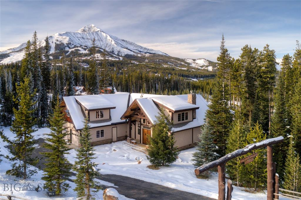 This custom home located on 20 acres in Ulery's Lakes in Moonlight Basin, offers private fishing access to Ulery's Lake and is only moments from one of Montana's premier ski resorts. The open floor plan of this 3,500± square foot home makes it live much larger. The great room features an abundance of windows taking in the expansive views, down into the Madison Valley. Custom log features throughout, granite countertops in the kitchen, slate showers and a grand staircase are only a few of the attributes of this mountain retreat. The Ulery's Lakes neighborhood offers access to three private, natural mountain fishing lakes, as well as private access via the Big Sky Roadway to the blue ribbon trout fishing on the Madison River.