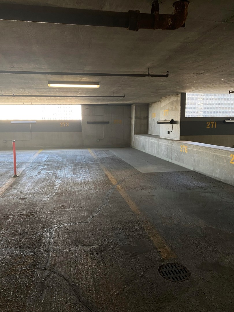 This is a Tandem parking space (fits 2 cars) on the 7th story of the indoor parking garage.  Great location, perfect for a large car or extra parking.
