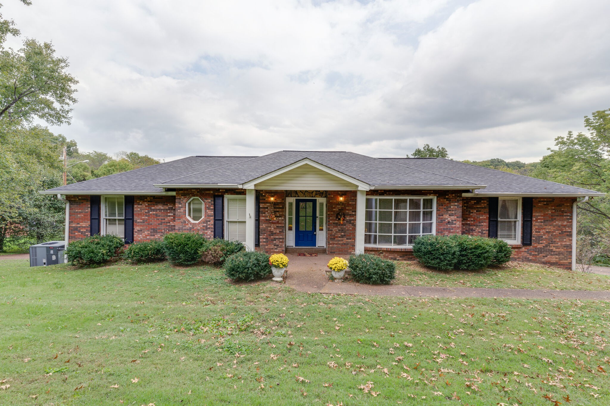 Just minutes from downtown Nashville, close to hospitals and interstate but nestled in a quiet and well established neighborhood. You'll love this HUGE yard with a private feel, open floor plan, all weather porch, 3 car garage and basement rec room!