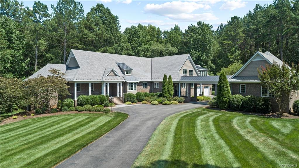 Extraordinary Custom-Built Home is Perfectly situated on a Private 2 Acre lot overlooking the Foundry Golf Course within the gated community of Greywalls. No Maintenance Quality 2X6 Construction includes All-Brick Exterior & Slate Tile roof on Main Home and Guest house.