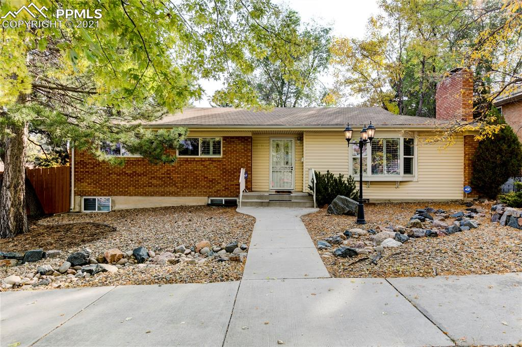"""You need to see this home! Top O The Town never looked so good. First off it's a huge home for this part of town. Over 2500 square feet, 4 beds, 2.5 baths, and an oversized, dettached 2 car garage and a meticulously cared for backyard; this home is sure to impress everyone.  The wood floors are recently refinished. The carpeting is GREAT condition. The kitchen features GRANITE COUNTERS, cherry cabinets, new appliances, and a exit to the backyard. The 52 foot by 16 foot TREX deck, the fully landscaped yard, mature trees, fully fenced yard, and the HOT TUB will enhance your experience with this home. The 6 foot high PRIVACY FENCE and HOT TUB makes this yard perfect for entertaining while giving you a private place to relax after a long day.  The master bedroom is what really sets this home apart. The master bath has been remodeled as well. The basement has a family room, 2 bedrooms, and a hobby space perfect for arts, crafts, or storage.  The 2 wood fireplaces are a great touch to this home and definitely add a """"cozy"""" factor. The main level has newer windows and PLANTATION BLINDS.  Overall this home has tons of charm, character, space, upgrades, and EXTRAS to really love."""