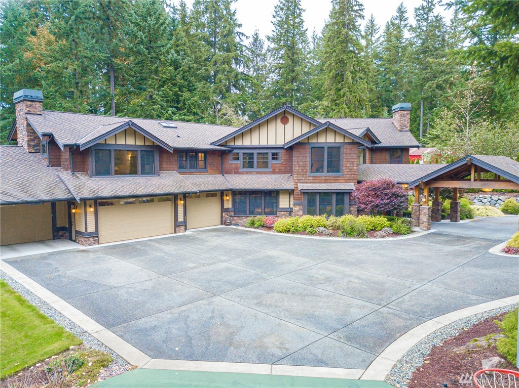 Luxury NW Lifestyle in this nearly 6000 sq ft 5 bdrm home on 1.28 acres is now available.  Luxury Resort style living every day. Arrive under the Porte-Cochere where you enter the Grand Foyer with soaring ceilings. Formal Living/Dining rooms & spacious Great Room/Gourmet Kitchen w/eating areas will let you entertain or just unwind. The Master suite is a true resort experience. Main Floor Guest Suite, Covered & uncovered Outdoor living spaces, Upstairs family & bonus rooms. Make an Appt today!