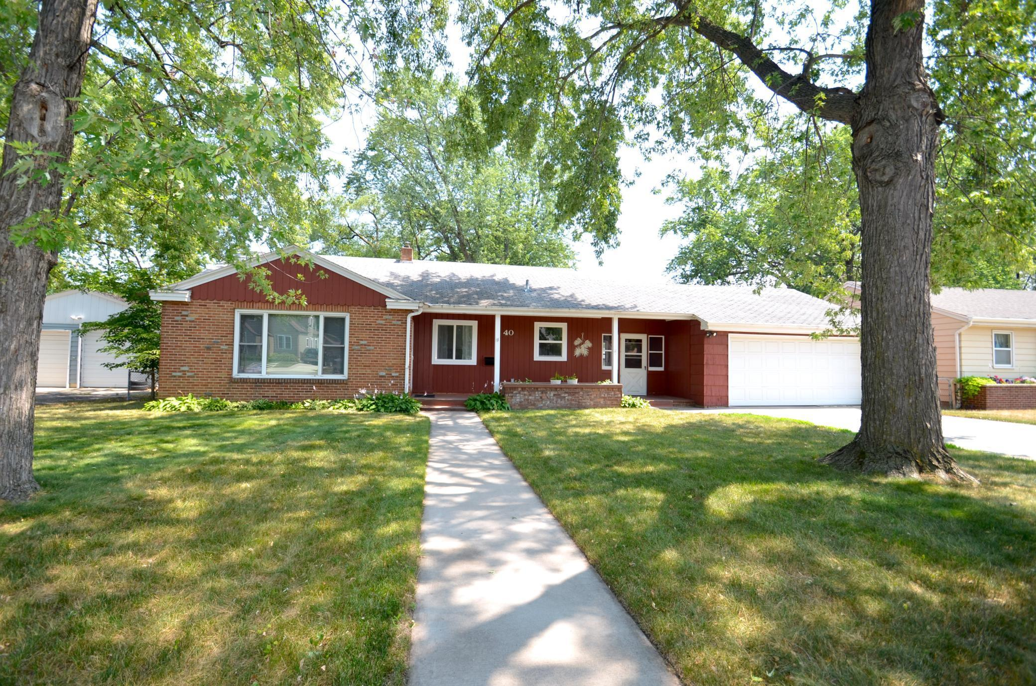 Exceptional rambler with many updates located in North St Cloud. Enter through the covered front porch, cozy living room with abundant natural light, beautifully remodeled kitchen with stainless steel appliances, new cabinets, countertops, breakfast bar, and dinette area. Main floor also features three bedrooms with newer carpet, built in storage space, and full bathroom. Lower level with  spacious family room w/ bar, office, bonus area would make a great reading nook, laundry/utility room, and storage. Breezeway between house and garage steps out into the fenced backyard with storage shed and concrete patio. Schedule your showing before it's gone!
