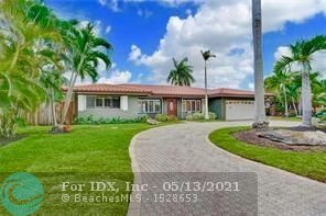 "LOVELY, EAST FORT LAUDERDALE HOME, LOCATED ON ONE OF THE BEST STREETS IN THE CORAL RIDGE COUNTRY CLUB NEIGHBORHOOD. FABULOUS OPEN LIVING SPACE, WITH MAGNIFICENT POOL VIEW FROM THE MOMENT YOU WALK INSIDE. FANTASTIC MASTER SUITE WITH TWO LARGE WALK IN CLOSETS. LUXURIOUS MASTER BATH, INCLUDING DUAL SINKS, SPACIOUS WALK IN SHOWER, AND SEPARATE TUB. BRAZILIAN WOOD FLOORS, ""S"" TILE ROOF, HURRICANE SHUTTERS, HUGE BACKYARD, COVERED PORCH, ON A QUIET STREET W/ NO TRAFFIC. STAINLESS STEEL APPLIANCES."