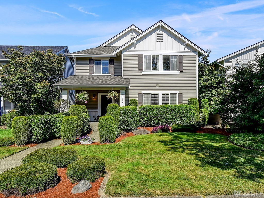 One of the best locations in the heart of Snoqualmie Ridge w/views of Mt Si. This 3 bed home w/covered front porch ftrs lrg dining rm perfect for entertaining. Chef's kitchen w/nook + walk-thru pantry, granite counters & island. Family rm w/gas fp & access to your fenced backyard w/fruit trees. Tranquil master ftrs a great work space, WIC & lrg 5 piece master bath. Spacious loft + 2 more beds both w/WIC + laundry upstairs. New roof, AC, newer furnace & H20 tank. Walk to shops, schools & trails