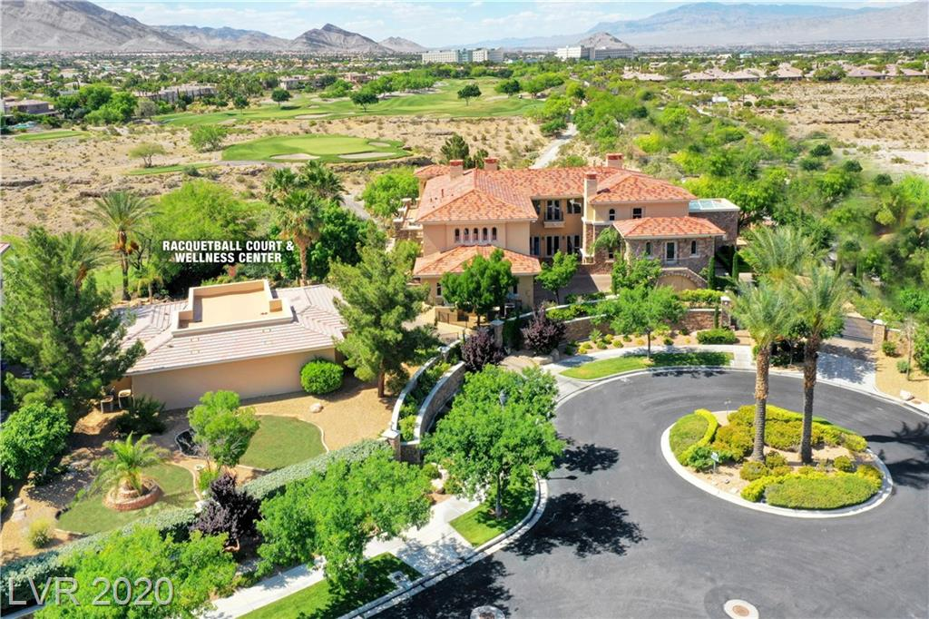 Stunning Summerlin estateon rare double golf course lot, this almost1 acre compound has been recently remodeledw/over$1,000,000 in upgrades, no expense spared. Privately gated estate boasting almost 10,000 sqft of perfection. Gourmet kitchenw/ La Cornue Chefscook center & designer Subzero & Miele appliances and all new custom oft close cabinets. This home offers everything from a climate controlled wine cellar with dumbwaiter, to a elegant piano bar with built in TV's and wet bar with ice maker.  Dream Master retreat w/sitting room, fireplace accented by custombuilt-ins and balcony with inspiringviews of The TPC Golf Course& Mountains.Spa like master bath completely redone in the latestcolors & styles. Out door oasis backyard cold plunge, waterfall and spa and a detached  fitness/wellness center offering a dry sauna, steam shower, gym area and underground racquetball court all cooled and heated space. Lush yard with mature landscape offering total privacy.  A must see!