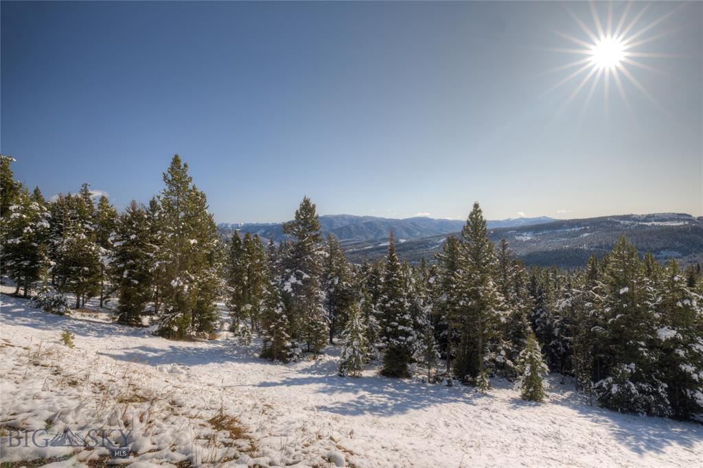 Panoramic views from this south facing parcel located on a quiet cut-de-sac road in the Spanish Peaks Mountain Club. Site your new Big Sky home amongst the Large old growth trees, and enjoy open space on one side of the property, as well as at the end of the cul-de-sac. The property offers close proximity to thew Spanish Peaks clubhouse, ski runs, golf course and more, and is also just a few minutes away from Big Sky's Town Center.