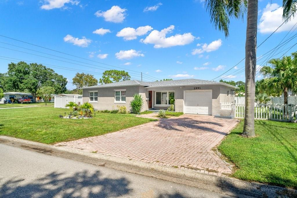 If you've been waiting for a spacious, well laid out 2/1 centrally located in St. Pete- this is it! A lot of thought and love went in to the improvements in this bright and airy home. From the contiguous vinyl flooring throughout to the crisp white kitchen and outdoor entertainment space everything was done with style and comfort in mind. In addition to the interior improvements, the roof was also replaced 4 years ago and AC is only 3 years old. This home is truly turn-key and ready for you to call your own.