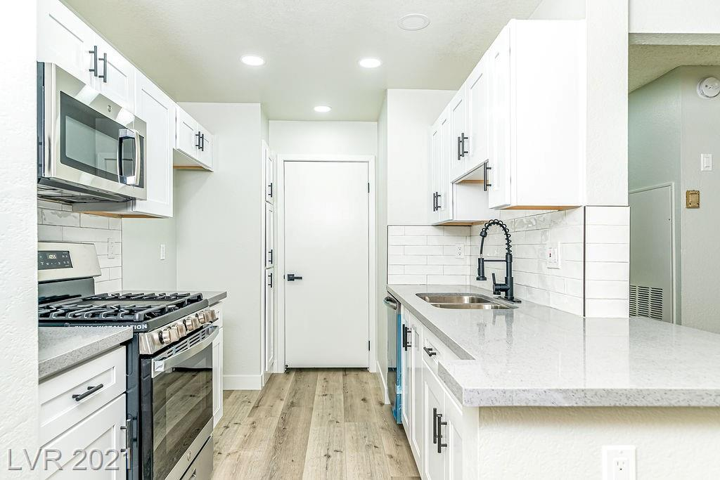 Fantastic GUARD GATED Condo!! DOUBLE MASTER!! TWO bedroom-TWO bath, UPDATED FRESHLY PAINTED INTERIOR and NEW flooring throughout, kitchen has been UPGRADED with NEW Cabinets & granite, NEW stainless steel appliances. Bathrooms have been upgraded w/CUSTOM showers and NEW Cabinets,