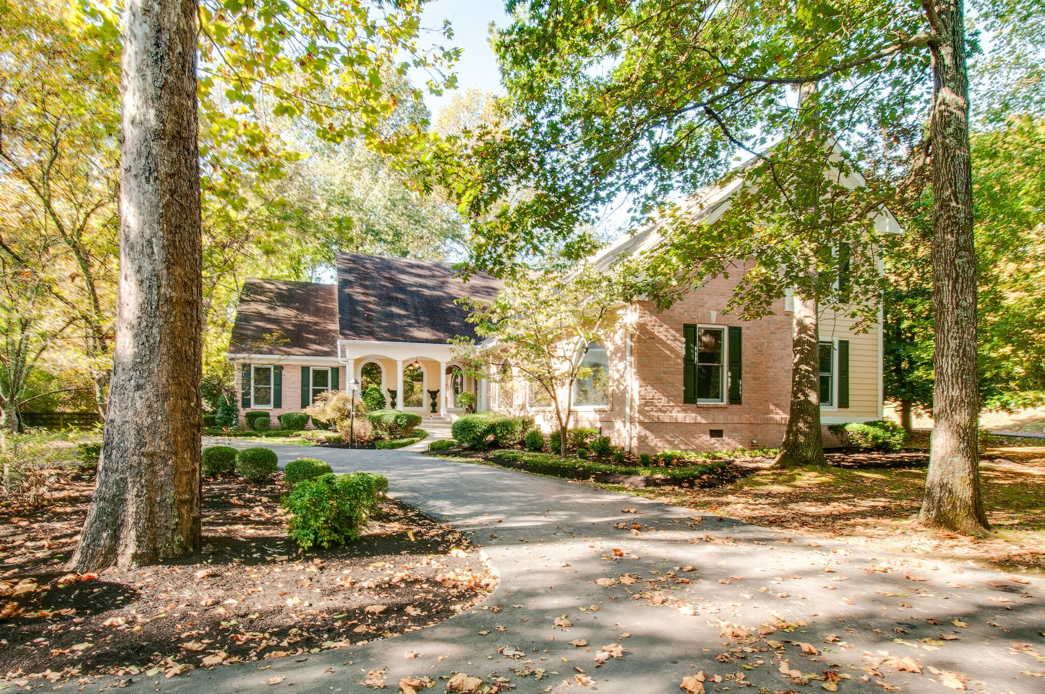 Convenient yet isolated, simply tucked away on a quiet street in the middle of Brentwood. Almost 1.5 acres, fully fenced & surrounded by a babbling brook creating the most serene setting. Floor to ceiling windows, custom built for a renowned music producer back in the day. Tons of storage, 4-car garage, hardwoods on main, beautiful sunroom with windows galore, open kitchen with ample cabinetry & large island for entertaining!