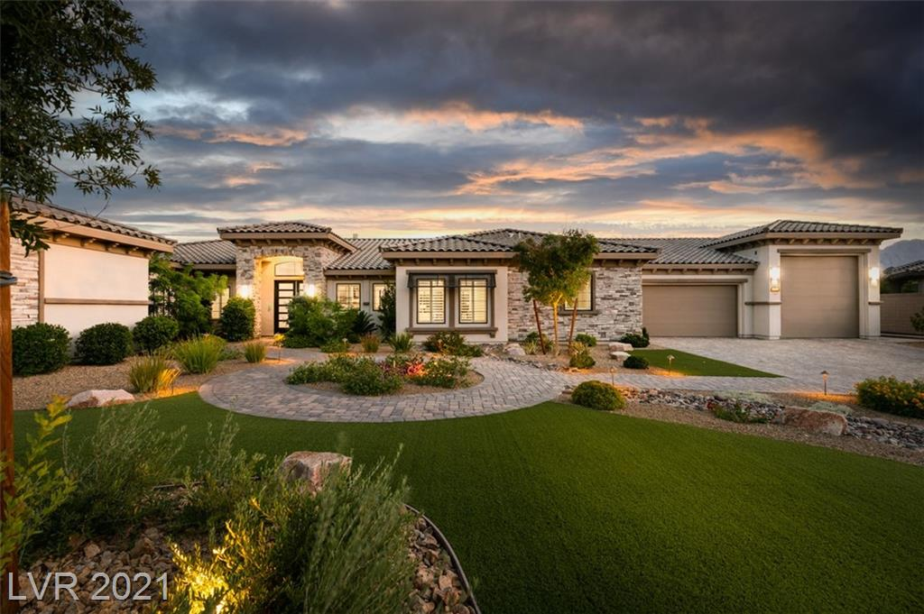 """One-of-a-Kind, semi-custom stunner w 4 car garage and RV GARAGE. Barely used 2nd home inside gated comm on cul-de-sac w mtn views. Massive kitchen island w waterfall/quartz counters, thermadore appliances, custom cabinets, and designer lighting. Wide open great room w 20' sliding doors opening onto resort backyard w pool, spa, putting green, covered patio, and rooftop deck. MULTI GEN living space complete w living room, dedicated bathroom, and spacious bedroom. Most custom furniture throughout included in sale. Garage includes separate bathroom, built in cabinets, dual system AC units, separate storage room, and PEBBLE ICE MACHINE. """"Move in Ready"""" is an understatement for this mountain beauty. Easy to see. Come by today!"""