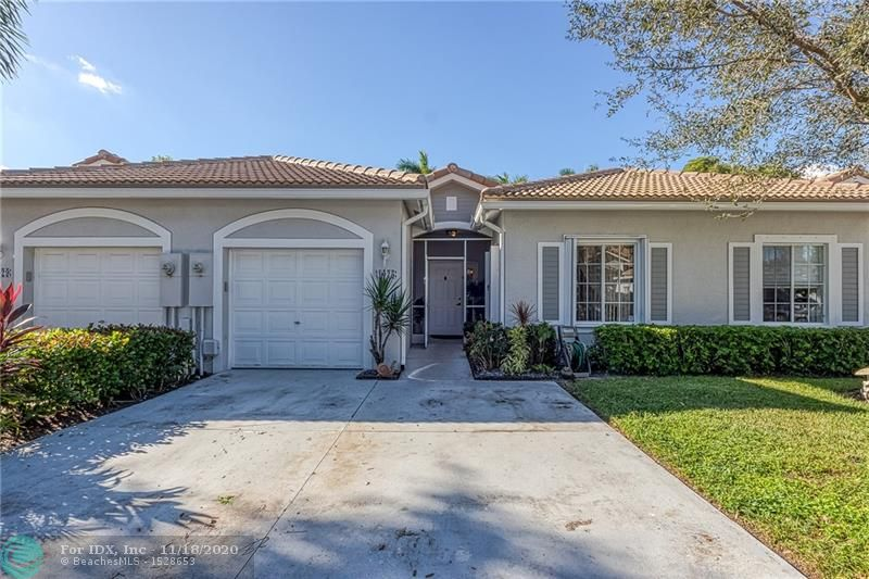 """COMPLETELY REMODELED with May 2019 ROOF and GUTTERS, this SPACIOUS (over 1600 sq ft) 2 Bedroom, 2 Bath is in IMMACULATE condition and MOVE-IN READY! A rare unit with ENCLOSED PATIO complete with IMPACT WINDOWS AND DOORS and PERMITS, it is TILED THROUGHOUT with a FORMAL entry, GOURMET KITCHEN complete with """"WATERFALL-EDGED"""" granite, EXPANSIVE bedrooms and SUMPTUOUS master bath!  Add in the OVERSIZED 4-TON air-conditioner, PREMIUM 2018 water heater, 1-car garage, a superb location IN THE HEART of DEERFIELD along with all that WATERWAYS has to offer - two POOLS, clubhouse, excellent on-site security - and this is a can't-miss property!"""