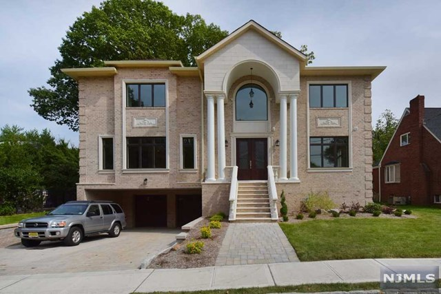 ELEGANT NEW CONSTRUCTION LOCATED ON A QUIET STREET IN THE UPSCALE BLUFF NEIGHBORHOOD OF FORT LEE. AMAZING FLOOR PLAN, GREAT FOR FAMILY LIVING AND ENTERTAINING. HIGH CEILINGS, CUSTOM MOLDINGS, LARGE DINING ROOM AND LIVING ROOMS WITH STATELY ARCHITECTURAL DETAILS. DREAM KITCHEN OUTFITTED W/CUSTOM CABINETRY, HUGE GRANITE ISLAND, PROF APPLIANCES AND A SEPARATE BUTLER'S STATION. THE GRAND, CIRCULAR STAIRCASE BRINGS YOU TO THE SECOND FLOOR, WITH AN ENORMOUS MASTER SUITE THAT FEATURES A CUSTOM FIREPLACE, AND TWO PROF DESIGNED CLOSETS. A MASTER, MARBLE BATHROOM INCLUDES AN OVERSIZED WHIRLPOOL TUB, HUGE STALL SHOWER, AND HIS/HER CUSTOM VANITIES. THE 3 BEDROOMS ON THE SECOND FLOOR EACH CONTAIN AN ENSUITE BATHROOMS,  THE HOME ALSO COMES WITH  CENTRAL TV/AV SYSTEM, HIGH-SPEED WIFI BOOSTERS, GENERATOR AND WIFI CONTROLLED HEATING, COOLING, GARAGE DOORS, CAMERAS AND ALARM. ADDITIONALLY, A PRIVATE BACKYARD IS GREAT FOR BOTH PLAY AND ENTERT, RADIANT FLOORS PLUS A HEATED GARAGE. MINUTES FROM NYC.