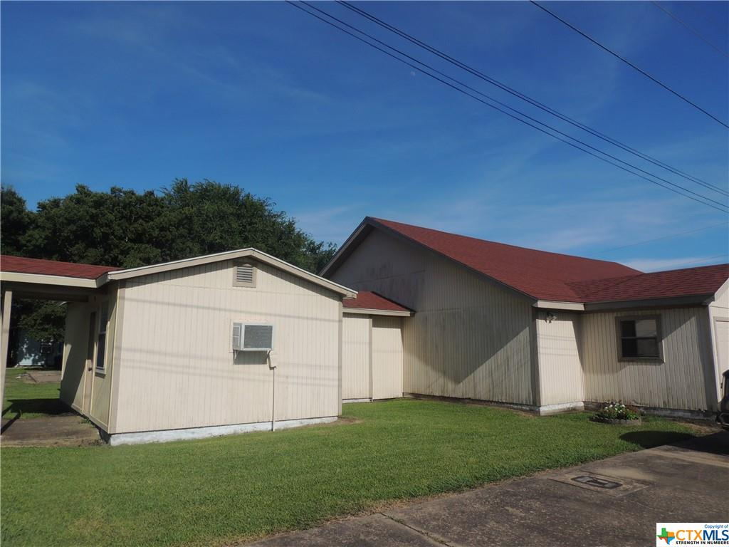 Church building located on two lots on the corner of Ritchie and 10th Street in Palacios. Concrete parking on two sides.