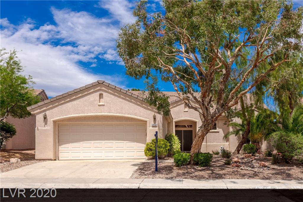 STUNNING south-facing GOLF COURSE & MOUNTAIN views from anywhere in this home! This home is located in the age-restricted 55+ community of Sun City MacDonald Ranch and offers a community center with a fitness room, restaurant, clubhouse, and social clubs and amenities. This Spacious 2Br +den, 2BA, floorplan features a formal living room & dining room, large kitchen with Corian counters, built-in fridge, breakfast counter, and plenty of storage space. It's perfect for entertaining as the kitchen opens to the cozy living room with a fireplace. Enjoy the covered patio overlooking the golf course and easy to maintain desert landscaping.
